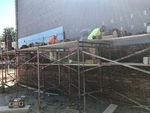 bricklayers-build-walls-build-communities